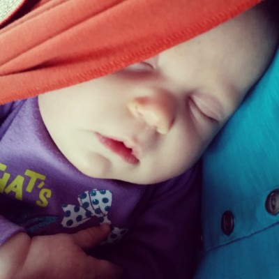 Sweet baby girl sleeping in the stretchy wrap.