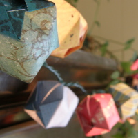 Decorate some Christmas lights with pretty homemade paper lanterns.
