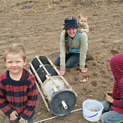 Planting garlic with the whole family. Wearing Grace on my back in the woven wrap.